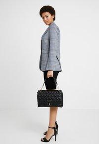 Guess - LAIKEN SHOULDER BAG - Handbag - black - 1
