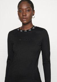 Calvin Klein Jeans - LOGO TRIM MILANO DRESS - Jersey dress - black - 3