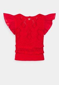 TWINSET - MAGLIA  SCOLLO V  - Camiseta estampada - corallo - 1