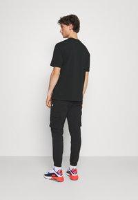 Nike Sportswear - TEE AIR LOOSE FIT - T-shirt med print - black - 2