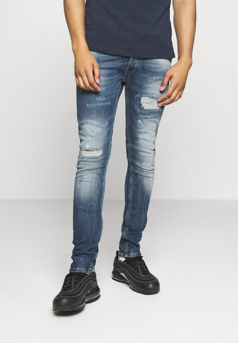 Tigha - MORTEN REPAIRED - Jeans slim fit - mid blue