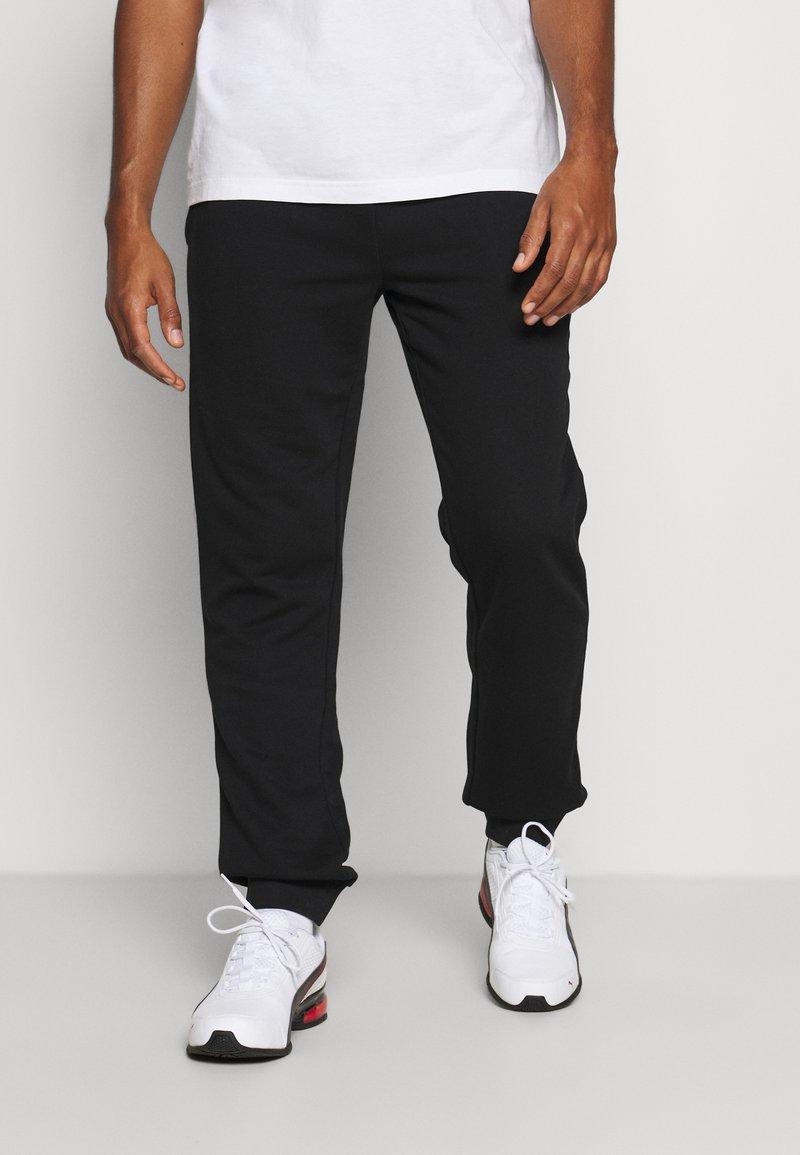 Fila - WILMET PANTS - Träningsbyxor - black