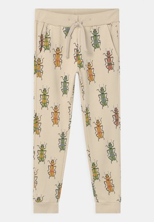 MINI BUGS UNISEX - Tracksuit bottoms - light beige
