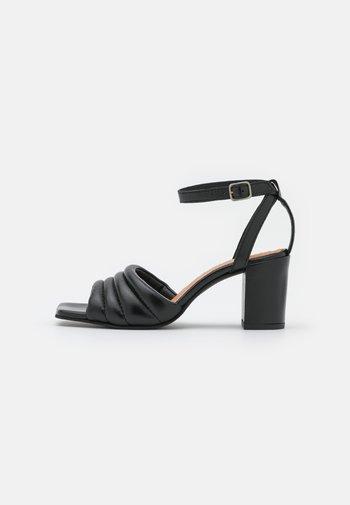 BERNE - Sandals - black