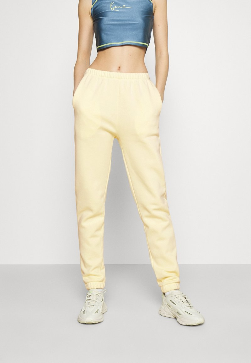 Nly by Nelly - COZY PANTS - Tracksuit bottoms - yellow