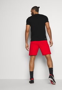 Lacoste Sport - SHORT TAPERED - Sports shorts - corrida/black - 2
