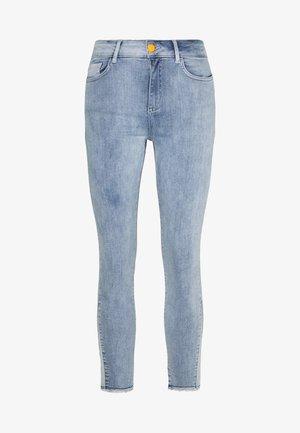 Skinny džíny - light blue denim