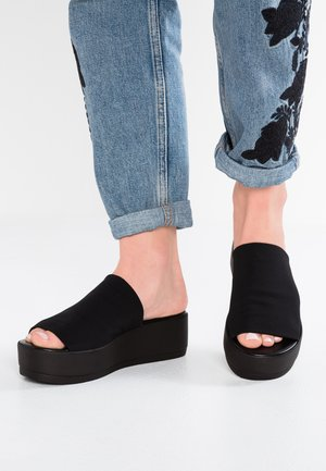 SLINKY - Heeled mules - black