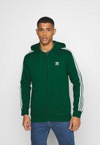 adidas Originals - STRIPES UNISEX - Mikina na zip - dark green - 0
