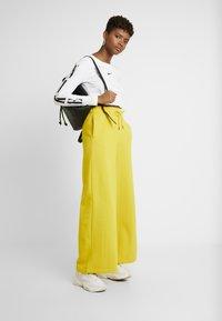 Nike Sportswear - PANT  - Træningsbukser - speed yellow/black - 1