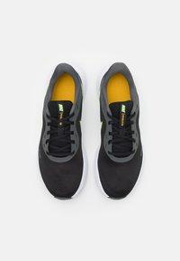 Nike Performance - REVOLUTION 5 - Zapatillas de running neutras - black/white/university gold/volt glow - 3