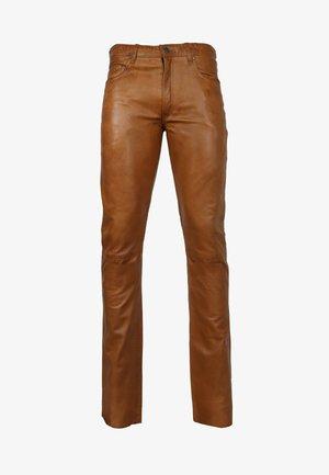 SLIM FIT - Leather trousers - cognac