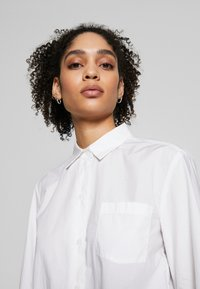 Marc O'Polo - BLOUSE LONG SLEEVEED TIE DETAIL AT HEM POCKET - Button-down blouse - white - 3
