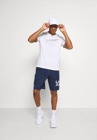 Under Armour - TECH WORDMARK SHORTS - Sports shorts - academy - 1