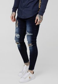 SIKSILK - LOW RISE DISTRESSED BURST KNEE - Jeans Skinny Fit - dark blue wash - 0
