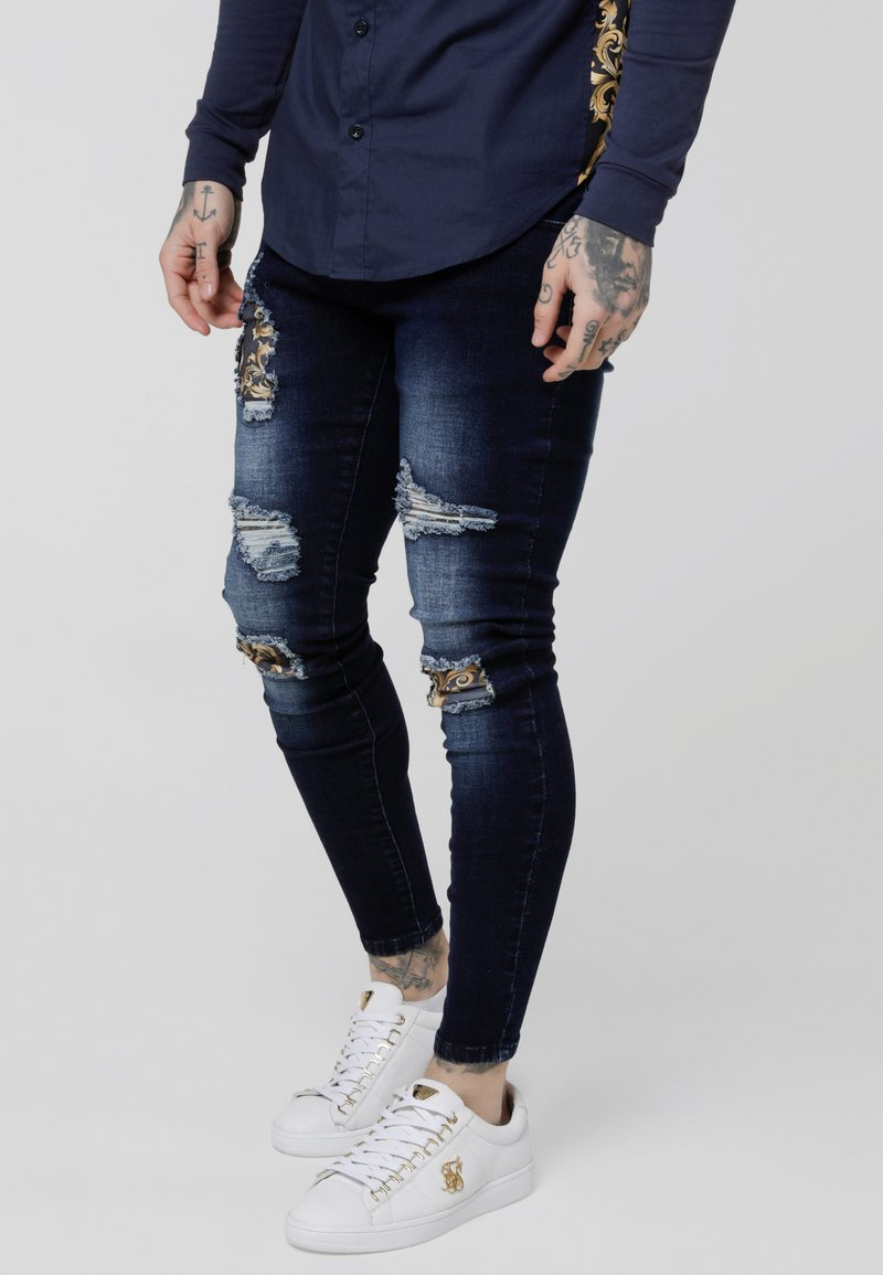 SIKSILK - LOW RISE DISTRESSED BURST KNEE - Jeans Skinny Fit - dark blue wash