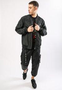 Ed Hardy - DRAG-CLOUD NYLON BOMBER JACKET - Summer jacket - black - 1