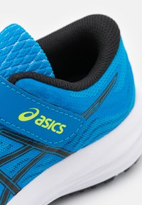 ASICS - PATRIOT 12 UNISEX - Neutral running shoes - directoire blue/black - 5
