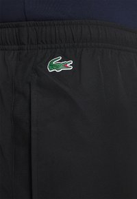 Lacoste Sport - TENNIS PANT TAPERED - Träningsbyxor - black/white - 4
