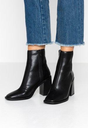OLIVEE - High heeled ankle boots - black