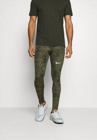 Nike Performance - Leggings - medium olive/white - 3