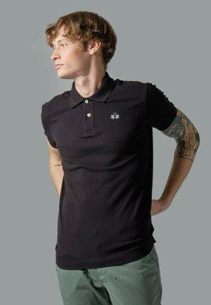 REALITY - Polo shirt - black