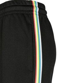 Urban Classics - DAMEN LADIES SIDE TAPED TRACK PANTS - Pantalones deportivos - black - 6