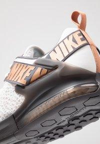Nike Performance - ZOOM DOMINATION TR 2 - Sports shoes - platinum tint/metallic copper/thunder grey/off noir - 5