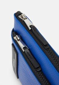 Furla - TECHNICAL CROSSBODY POUCH UNISEX - Across body bag - bluette - 4