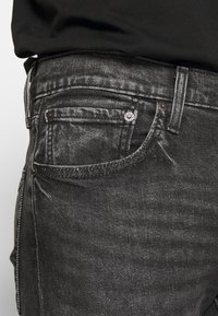 Levi's® - SKINNY TAPER - Vaqueros pitillo - black denim - 5