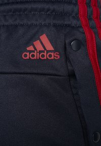 adidas Performance - SNAP - Tracksuit bottoms - dark blue - 6