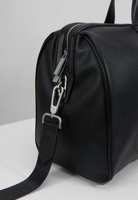 Calvin Klein - PUNCHED - Weekend bag - black