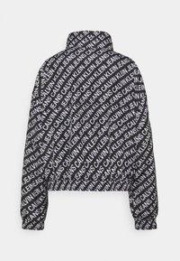 Calvin Klein Jeans - PACKABLE HOOD WINDBREAKER - Summer jacket - black - 8