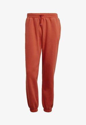 Pantalones deportivos - orange