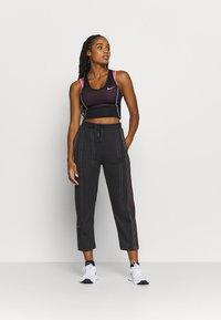 Nike Performance - PANT - Tracksuit bottoms - black - 1