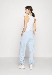 NEW girl ORDER - KANJI JOGGERS - Tracksuit bottoms - blue - 2