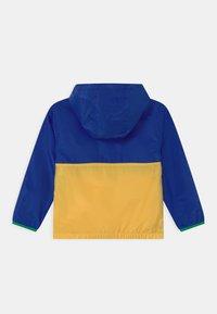 Polo Ralph Lauren - OUTERWEAR - Vodotěsná bunda - sapphire star/yellow - 1