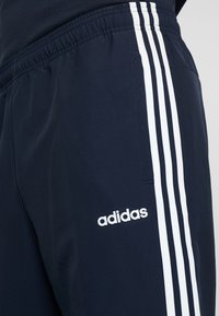 adidas Performance - WIND - Spodnie treningowe - blue
