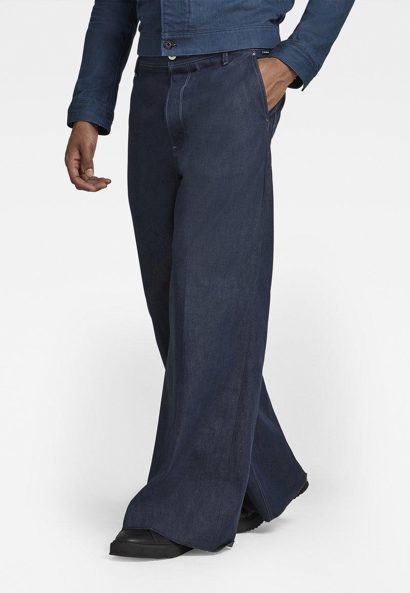 G-Star - GRIP 36 LOOSE - Flared Jeans - kara steel denim - raw denim
