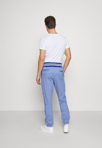 Schott - PHIL - Tracksuit bottoms - heather blue - 2