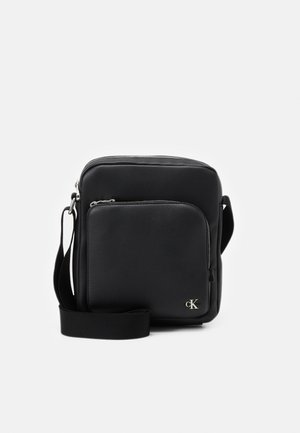 REPORTER ZIP UNISEX - Across body bag - black