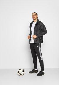 adidas Performance - TIRO 21 - Tracksuit bottoms - black/white - 1