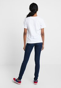 Monki - OKI - Slim fit jeans - mid blue