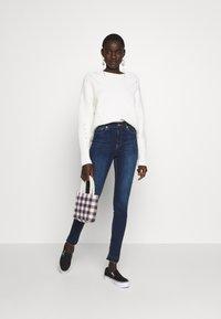 NA-KD Tall - HIGH WAIST OPEN - Jeans Skinny Fit - dark blue - 1