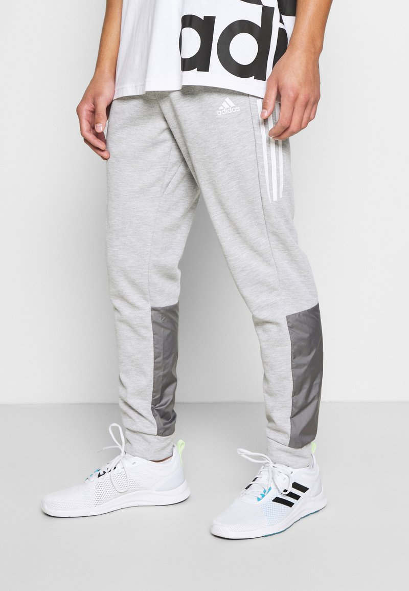 adidas Performance - MUST HAVES AEROREADY SPORTS REGULAR PANTS - Tracksuit bottoms - mottled dark grey