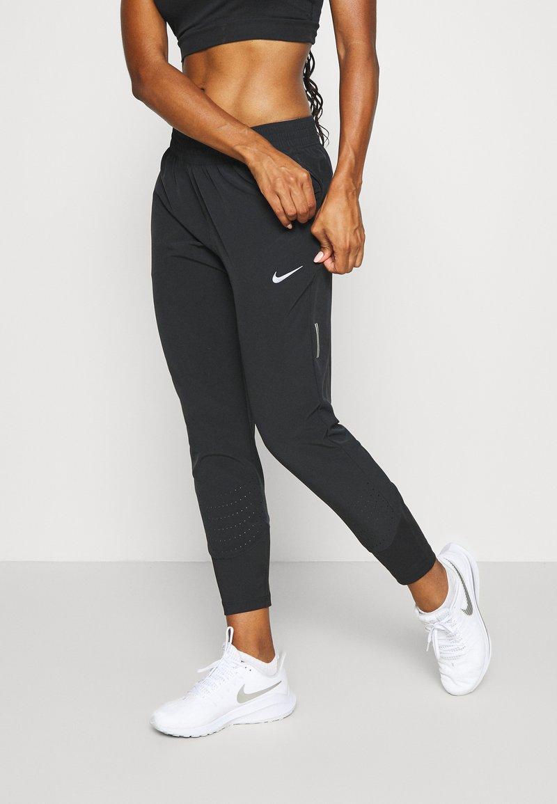 Nike Performance - SWIFT PANT - Pantalones deportivos - black/reflective silver