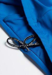 Intimissimi - Swimming shorts - blue longbay - 4