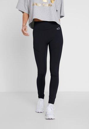 SOLVEIG  - Leggings - black