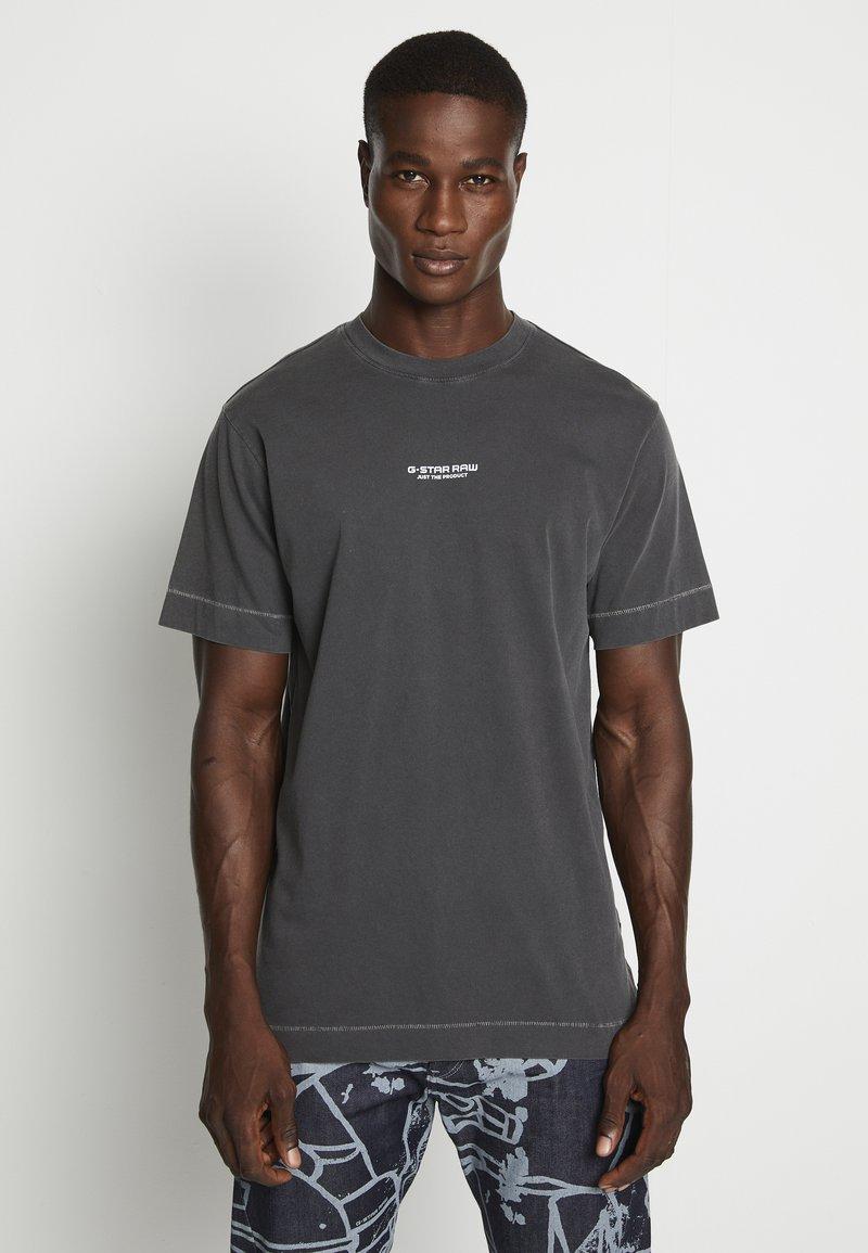 G-Star - REFLECTIVE LOGO LOOSE OD R T S\S - T-shirt z nadrukiem - compact black