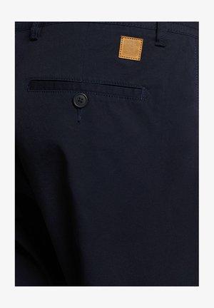 ARNE - Spodnie materiałowe - navy